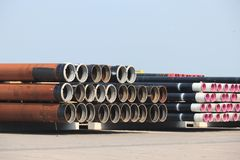 Rusty stacked pipes. At an industrial storage stock photos