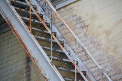 Rusty staircase at an old wall Stock Photos