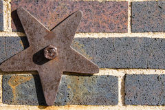 Rusty star on brick wall Royalty Free Stock Photo