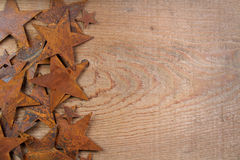 Rusty stars on a wooden background Stock Photography