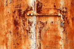Rusty steel. Texture on bolted iron door Royalty Free Stock Photography