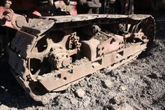Rusty steel bulldozer track and wheels royalty free stock images