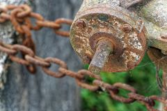 Rusty steel chain element, industrial background for commercial use.  stock photos