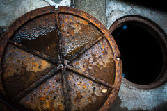 Rusty steel manhole cover Royalty Free Stock Photo