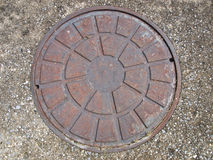 Rusty Steel Manhole Cover Royalty Free Stock Images