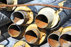 Rusty steel pipe with heat insulation Royalty Free Stock Photography