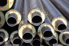 Rusty steel pipe with heat insulation Royalty Free Stock Image