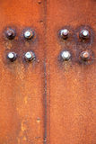 Rusty steel plate and screw Stock Image