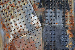 Rusty steel plates with rivets. And peeling paint Royalty Free Stock Photos