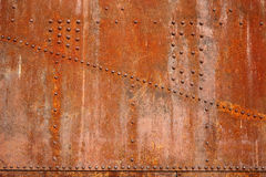 Rusty steel rivets. On the steel sheet royalty free stock photos