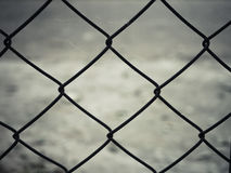 Rusty steel wire mesh fence. Close up Stock Image