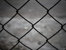 Rusty steel wire mesh fence. Close up Stock Photos
