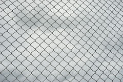 Rusty steel wire mesh fence , cloud in background Royalty Free Stock Image