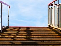 rusty steps of metal outdoor stairs to blue sky stock photos