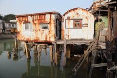 Rusty stilt houses royalty free stock photos