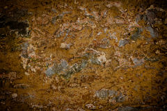 Rusty stone wall Royalty Free Stock Image