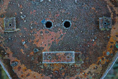Rusty surface with holes. Royalty Free Stock Photo