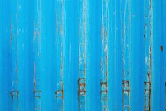 Rusty surface of metal plate with blue cracked color paint. Rust on old colored metal. royalty free stock photo