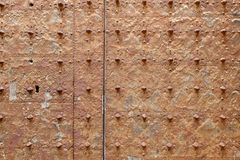 Rusty surface of an old medieval church door royalty free stock image