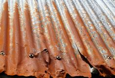 Rusty surface. Rough rusty surface, orange and grey corrugated sheet Royalty Free Stock Photography
