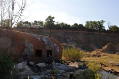 Rusty tank. In a deep ravine Stock Photography