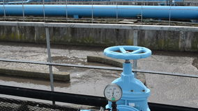 Rusty tap water treatment. Panorama of blue valve gate stopcock for oxygen blowing in sewage water and pipes in treatment plant and dirty liquid bubble stock video