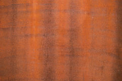 Rusty textured wall. Red shade Royalty Free Stock Photos