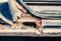 Rusty threshold of car used as backgroun. Stock Image