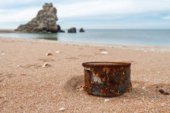 Rusty tin can on the beach. Rusty tin can on beach - concept of environment background Stock Photography