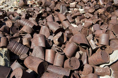 Rusty tin cans in desert. Old abandoned hillsidetown town dump in American desert Stock Photo