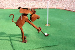 Rusty Tin Dog. Playing golf. Shot with Canon 20D royalty free stock photo