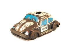 Rusty tin toy. Old, rusty tin toy. Police car Royalty Free Stock Photos