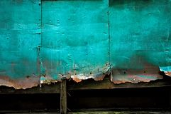 Rusty Tin Wall Background. A background texture of a green, grungy and rusty tin wall royalty free stock image