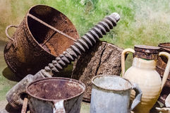 Rusty tools in an ancient underground oil mill in Italy Royalty Free Stock Images