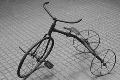 Rusty toy bikes. A rusty old metal toy in the shape of a bike Royalty Free Stock Image