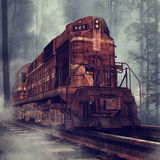 Rusty train in a forest. Old rusty train and tracks in a foggy forest Royalty Free Stock Photos