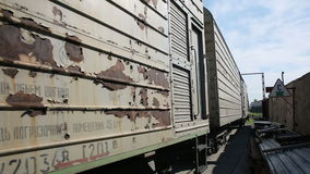 Rusty train rides on the loading. Production area. Vehicle outdoors stock footage