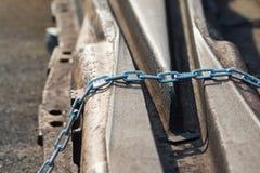 Rusty Train Tracks and Chain Stock Photography