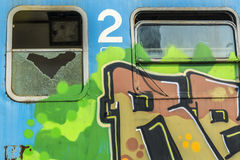 Rusty train wagons. Out of service train wagon covered by graffiti with a heart shape broken window Stock Photo