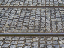 Rusty tram rail line track with gray cobble stone in prague royalty free stock photos