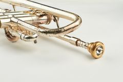 Rusty trumpet with mouthpiece close up. Part of classical trumpet on light background. Design of retro jazzy instrument royalty free stock photos