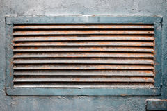 Rusty ventilation grille in metal wall. Rusty old ventilation grille on metal wall painted in blue Royalty Free Stock Photo