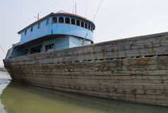 Rusty Vessel. Blue rusty vessel in a canal in Jakarta harbor Royalty Free Stock Photo