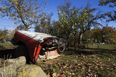 Rusty vintage car cut in half on a sunny day in autumn Stock Photos