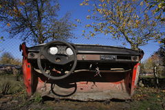 Rusty vintage car cut in half on a sunny day in autumn Stock Images