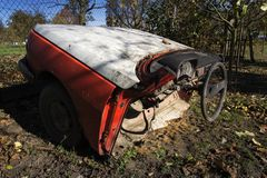 Rusty vintage car cut in half on a sunny day in autumn Stock Photography