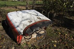 Rusty vintage car cut in half on a sunny day in autumn Royalty Free Stock Photo