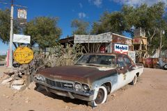 Rusty vintage car in Hackberry, Arizona. November 10, 2015 Hackberry, Arizona,USA: rusty vintage sheriff`s car exhibited at Hackberry General Store on the scenic royalty free stock photography