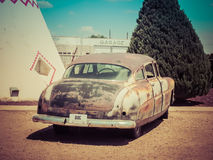 Rusty Vintage Car. With license plate of Doc Hudson, this rusty vintage car is located at the Wigwam Motel in Holbrook, Arizona royalty free stock photos