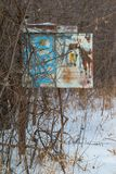 A rusty vintage old phone box I think on a pole that no longer had a phone in it - next to remote area railroad tracks - cold sn. Owy wintery day stock images